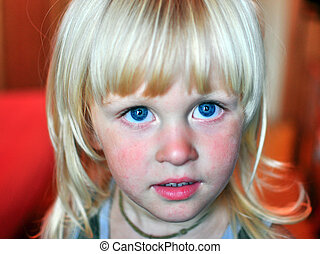 Portrait of a blond child with blue eyes
