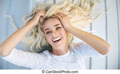 Portrait of a blond lying woman - Portrait of a blond lying ...