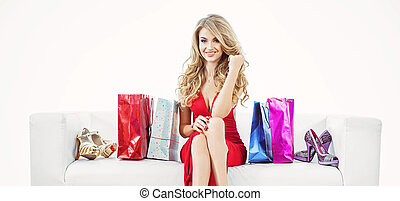 Portrait of a blond woman with a bunch of shopping bags
