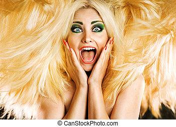 Portrait of a blond yelling cutie