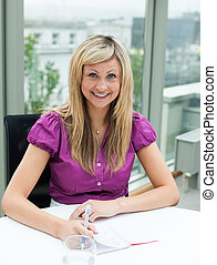 Portrait of a blonde businesswoman smiling at the camera