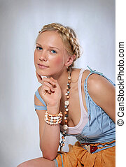 Portrait of a blonde girl with a braid
