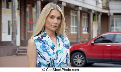 Portrait of a blonde on a background of parking - Girl on a...