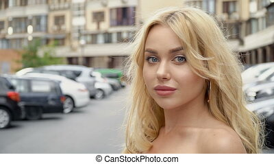 Portrait of a blonde with full lips and blue eyes on a...