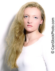 Portrait of a blonde with long hair.