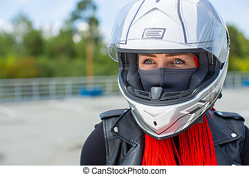 Portrait of a blue-eyed girl in a white helmet.