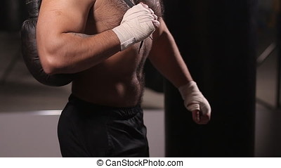 Portrait of a boxer with gloves for boxing. Man after kickboxing training