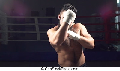 Portrait of a boxer working out the bumps in the ring. A young man in training for Boxing