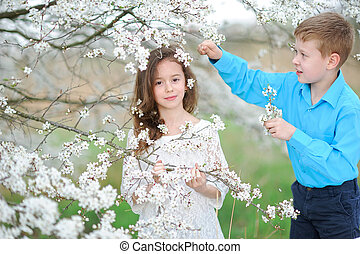Portrait of a boy and girl in the lush garden