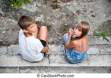 Portrait of a boy and teenage girl.