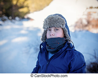 Portrait of a boy close-up in winter