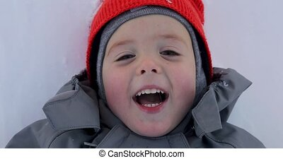 Portrait of a boy close up in winter. The face of the child...