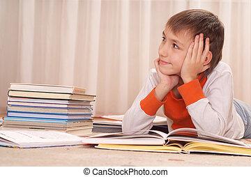 boy does homework at home