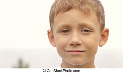 Portrait of a boy outdoors - Portrait of a child close-up in...