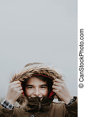 portrait of a boy sheltered in winter