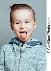 Portrait of a boy sticking out his tongue