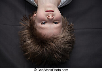 Portrait of a boy upside down