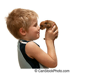 Portrait of a boy with a little puppy
