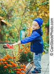 Portrait of a boy working in the garden