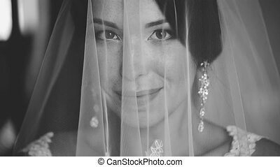 Portrait of a Bride Covered With Veil