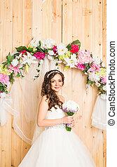 Portrait of a bride with wedding bouquet