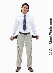 Portrait of a broke businessman showing his empty pockets...