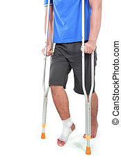 portrait of a broken foot using crutch trying to walk...