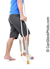 portrait of a broken foot using crutch