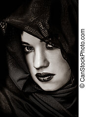 Portrait of a brunette hiding girl