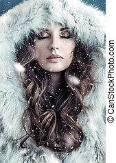 Portrait of a brunette lady wearing hooded fur coat