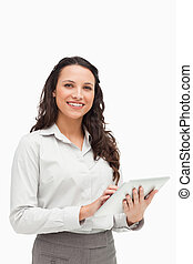 Portrait of a brunette standing while using a touchpad