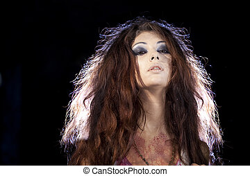 Portrait of a brunette with backlighting