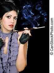 Portrait of a brunette with cigarette holder