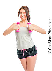 Portrait of a brunette with pink dumbbells