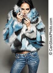 Portrait of a brunette woman wearing fur coat