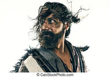 Portrait of a brutal bald-headed viking in a battle posing...