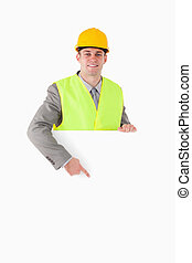Portrait of a builder pointing at something