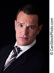 Portrait of a business man isolated on black background. Studio shot.