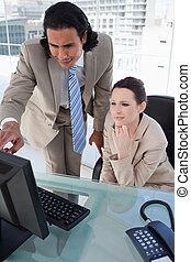 Portrait of a business team using a computer