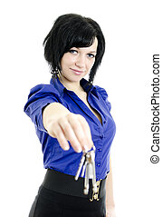 Portrait of a business woman holding keys. Isolated on white background