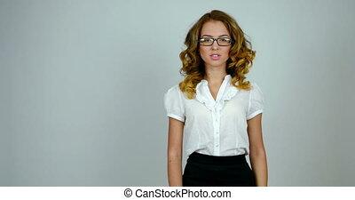 Portrait of a business woman in a studio. Medium shot. -...