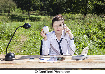 Portrait of a business woman, office outside, fresh air