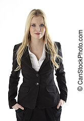 Portrait of a business woman with hands in pockets standing...