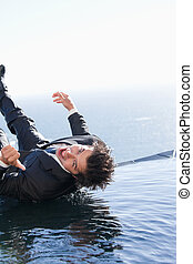 Portrait of a businessman falling into water