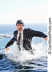 Portrait of a businessman going out of the water