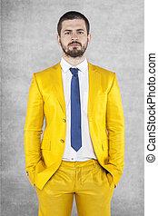 Portrait of a businessman in a gold suit