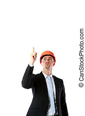 Portrait of a businessman in helmet pointing up at copyspace over white background