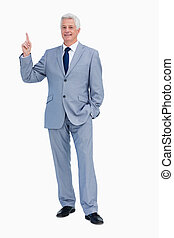 Portrait of a businessman pointing up