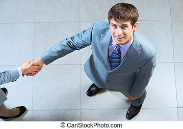 Portrait of a businessman shaking hand