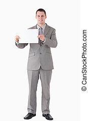 Portrait of a businessman showing a blank panel